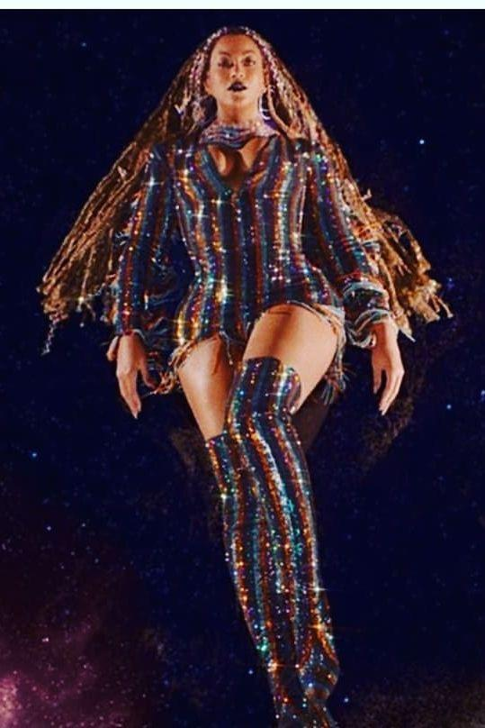 <p>Beyoncé wears a custom crystal dress and boots by Vrettos Vrettakos and a necklace by Laurel Dewitt.</p>
