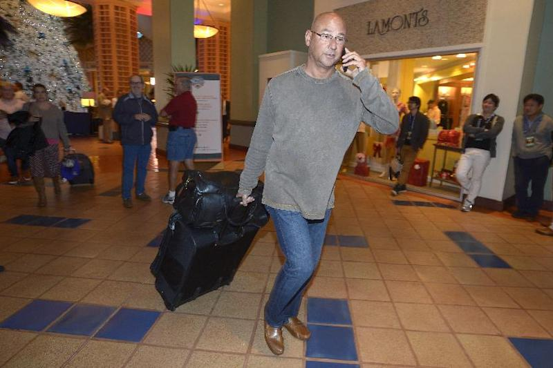 Cleveland Indians manager Terry Francona leaves after the conclusion of baseball's winter meetings in Lake Buena Vista, Fla., Thursday, Dec. 12, 2013.(AP Photo/Phelan M. Ebenhack)