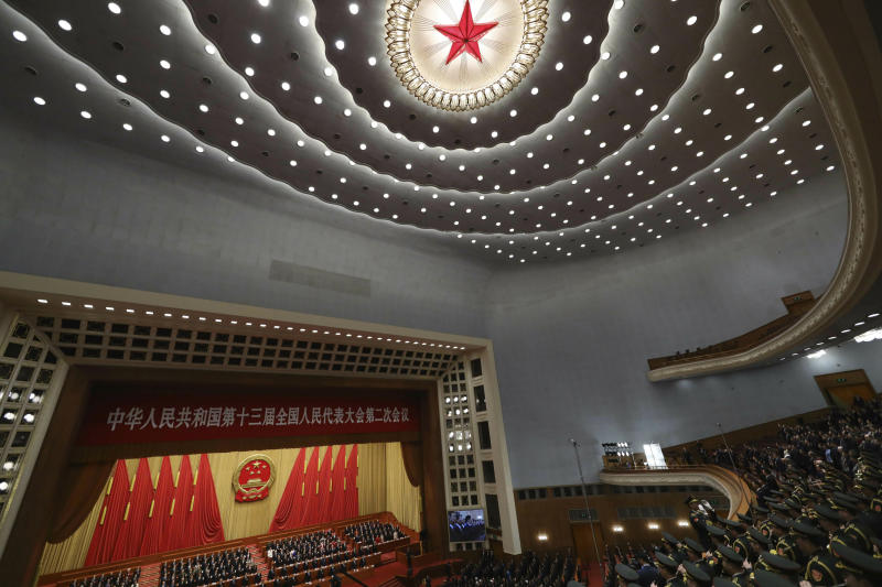 A military band plays the national anthem during the closing session of the National People's Congress in Beijing's Great Hall of the People on Friday, March 15, 2019. (AP Photo/Ng Han Guan)