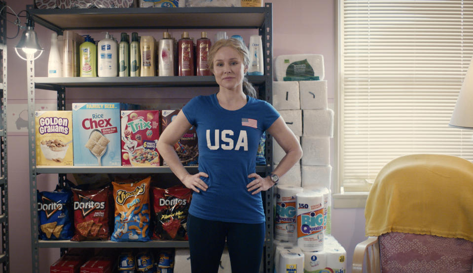 """This image released by STX Films shows Kristen Bell in a scene from """"Queenpins."""" (STX Films via AP)"""