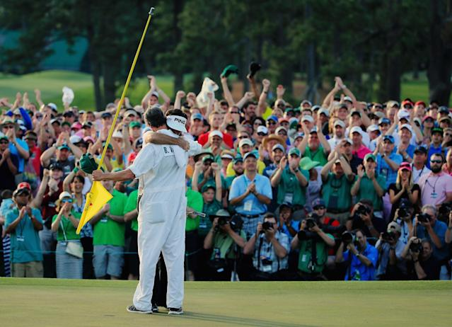 AUGUSTA, GA - APRIL 13: Bubba Watson of the United States hugs his caddie Ted Scott on the 18th green after winning the 2014 Masters Tournament by a three-stroke margin at Augusta National Golf Club on April 13, 2014 in Augusta, Georgia. (Photo by David Cannon/Getty Images)