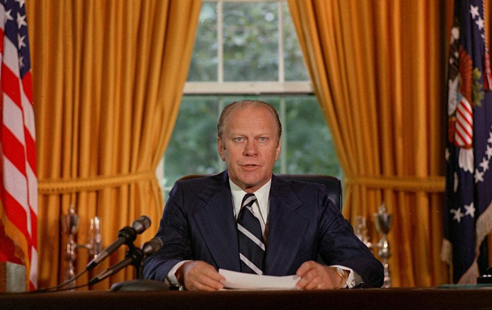 "President Gerald Ford reads a proclamation in the White House on Sept. 8, 1974 granting former president Richard Nixon ""a full, free and absolute pardon"" for all ""offenses against the United States"" during the period of his presidency. (Photo: ASSOCIATED PRESS)"