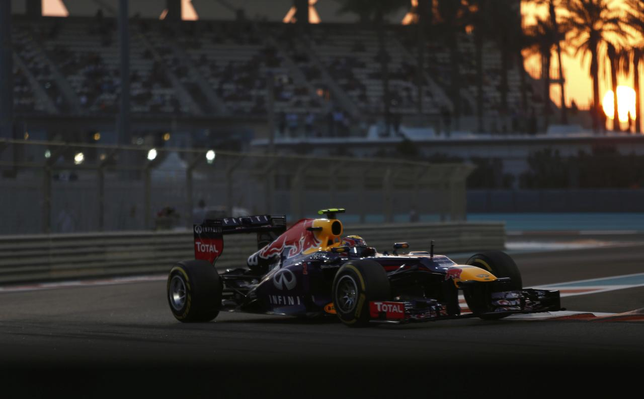 Red Bull Formula One driver Mark Webber of Australia takes a corner during the qualifying session of the Abu Dhabi F1 Grand Prix at the Yas Marina circuit on Yas Island, November 2, 2013. REUTERS/Ahmed Jadallah (UNITED ARAB EMIRATES - Tags: SPORT MOTORSPORT F1)