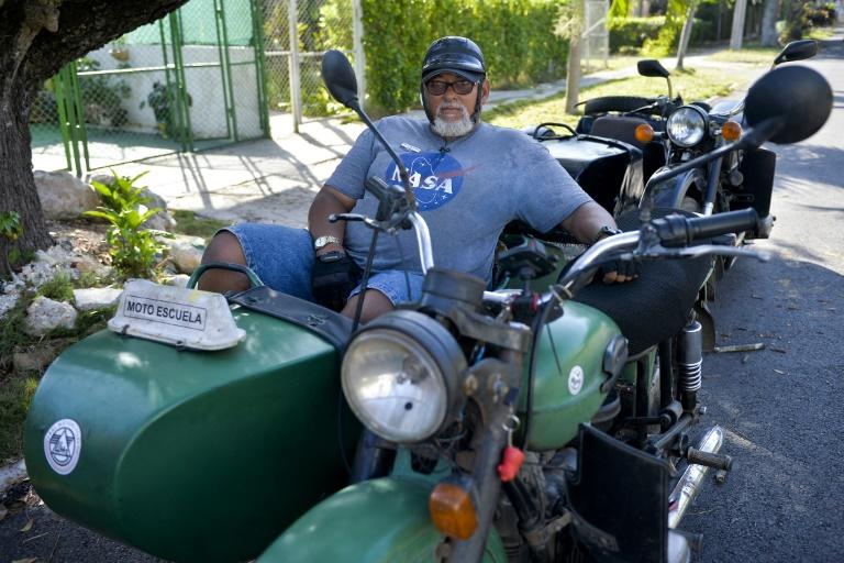 "The retro appeal gets a lot of attention from tourists ""but here it's common, normal,"" says Enrique Oropesa Valdez, 59, who teaches people how to handle motorcycle sidecars in Havana's traffic"