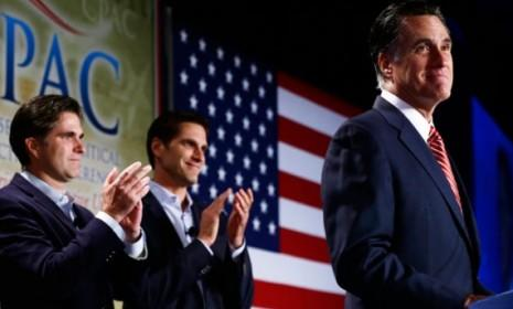 Mitt Romney is applauded by sons Josh (center) and Tagg (left) on Oct. 4: Tagg, the eldest Romney son, was not pleased with President Obama's aggression in the Oct. 16 debate.