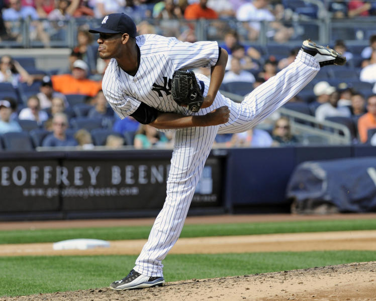 New York Yankees pitcher Ivan Nova delivers the ball to the San Francisco Giants during the sixth inning of an inter-league baseball game Saturday, Sept. 21, 2013, at Yankee Stadium in New York. (AP Photo/Bill Kostroun)