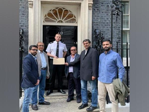 SBF Members handing the petition over to the UK Prime Minister Boris Johnson. (Facebook/SBF)
