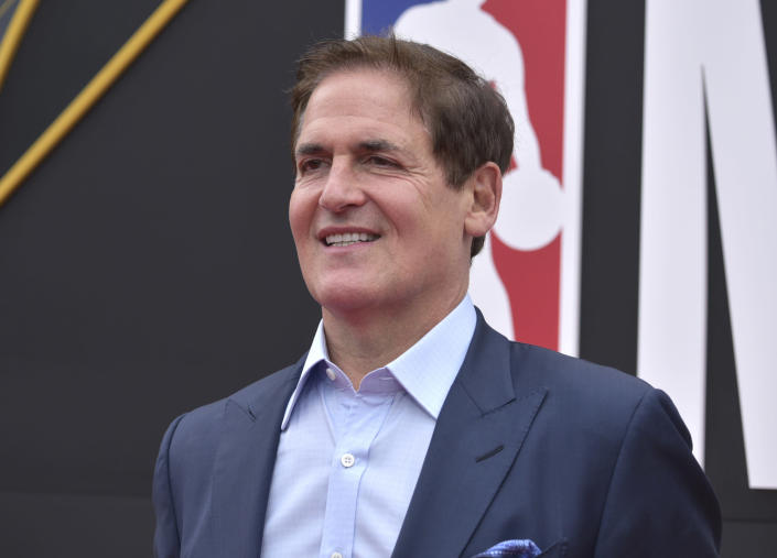 """FILE - Dallas Mavericks owner Mark Cuban arrives at the NBA Awards in Santa Monica, Calif., in this Monday, June 24, 2019, file photo. The NBA said Wednesday, Feb. 10, 2021, the national anthem will be played in arenas """"in keeping with longstanding league policy"""" after Dallas Mavericks owner Mark Cuban revealed he had decided not to play it before his team's home games this season. (Photo by Richard Shotwell/Invision/AP, File)"""