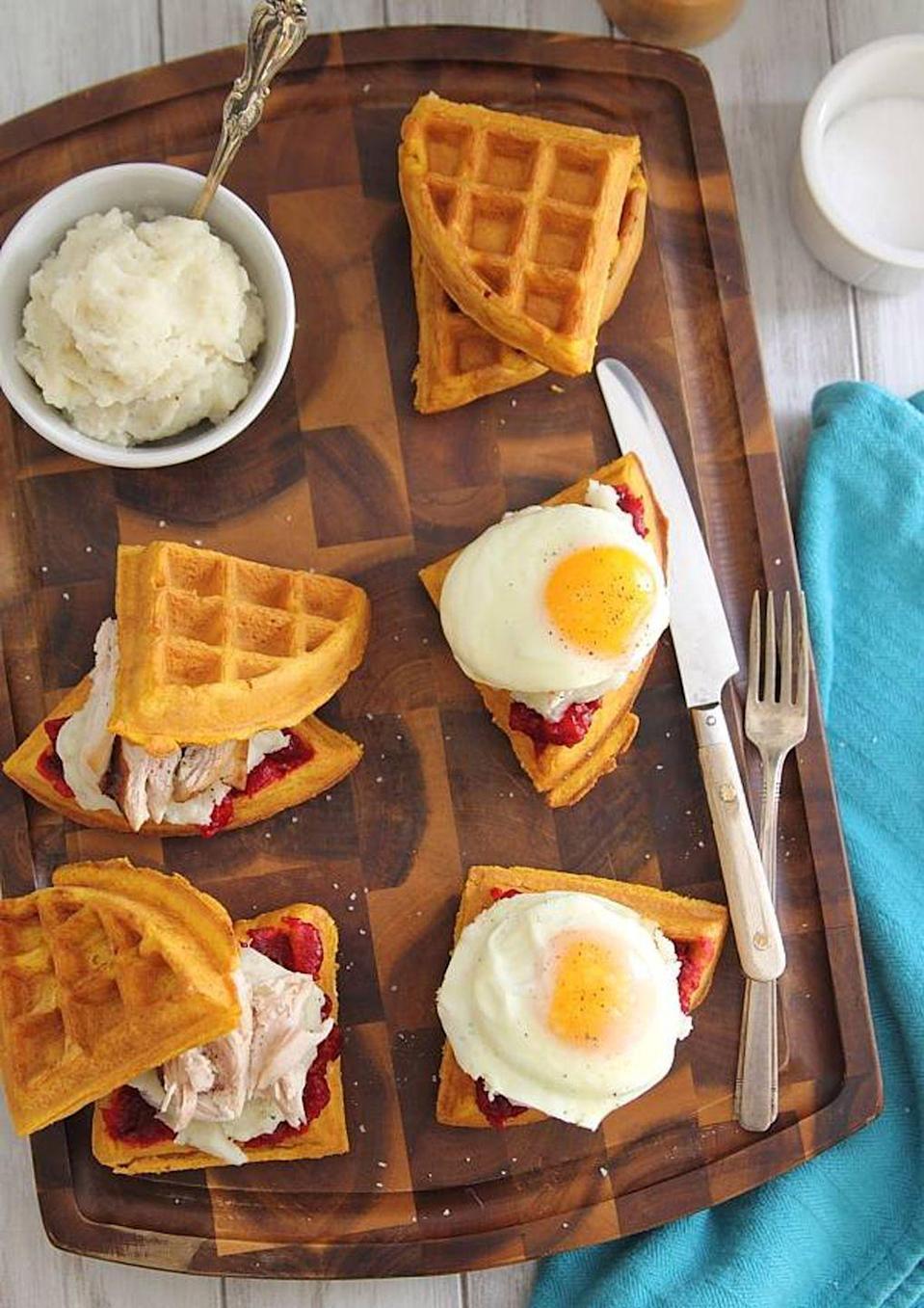 """<p>Pile mashed potatoes, cranberry sauce, turkey, and an over-easy egg on top of pumpkin waffles for an early morning treat that truly captures all the <a href=""""https://www.countryliving.com/food-drinks/g1921/easy-fall-recipes/"""" rel=""""nofollow noopener"""" target=""""_blank"""" data-ylk=""""slk:best tastes of fall."""" class=""""link rapid-noclick-resp"""">best tastes of fall.</a><br></p><p><strong>Get the recipe at <a href=""""https://www.runningtothekitchen.com/thanksgiving-leftover-waffle-breakfast-sandwiches/"""" rel=""""nofollow noopener"""" target=""""_blank"""" data-ylk=""""slk:Running to the Kitchen"""" class=""""link rapid-noclick-resp"""">Running to the Kitchen</a>.</strong></p><p><a class=""""link rapid-noclick-resp"""" href=""""https://www.amazon.com/Presto-Ceramic-FlipSide-Belgian-Waffle/dp/B000TYBWIG?tag=syn-yahoo-20&ascsubtag=%5Bartid%7C10050.g.2144%5Bsrc%7Cyahoo-us"""" rel=""""nofollow noopener"""" target=""""_blank"""" data-ylk=""""slk:shop waffle makers"""">shop waffle makers</a></p>"""