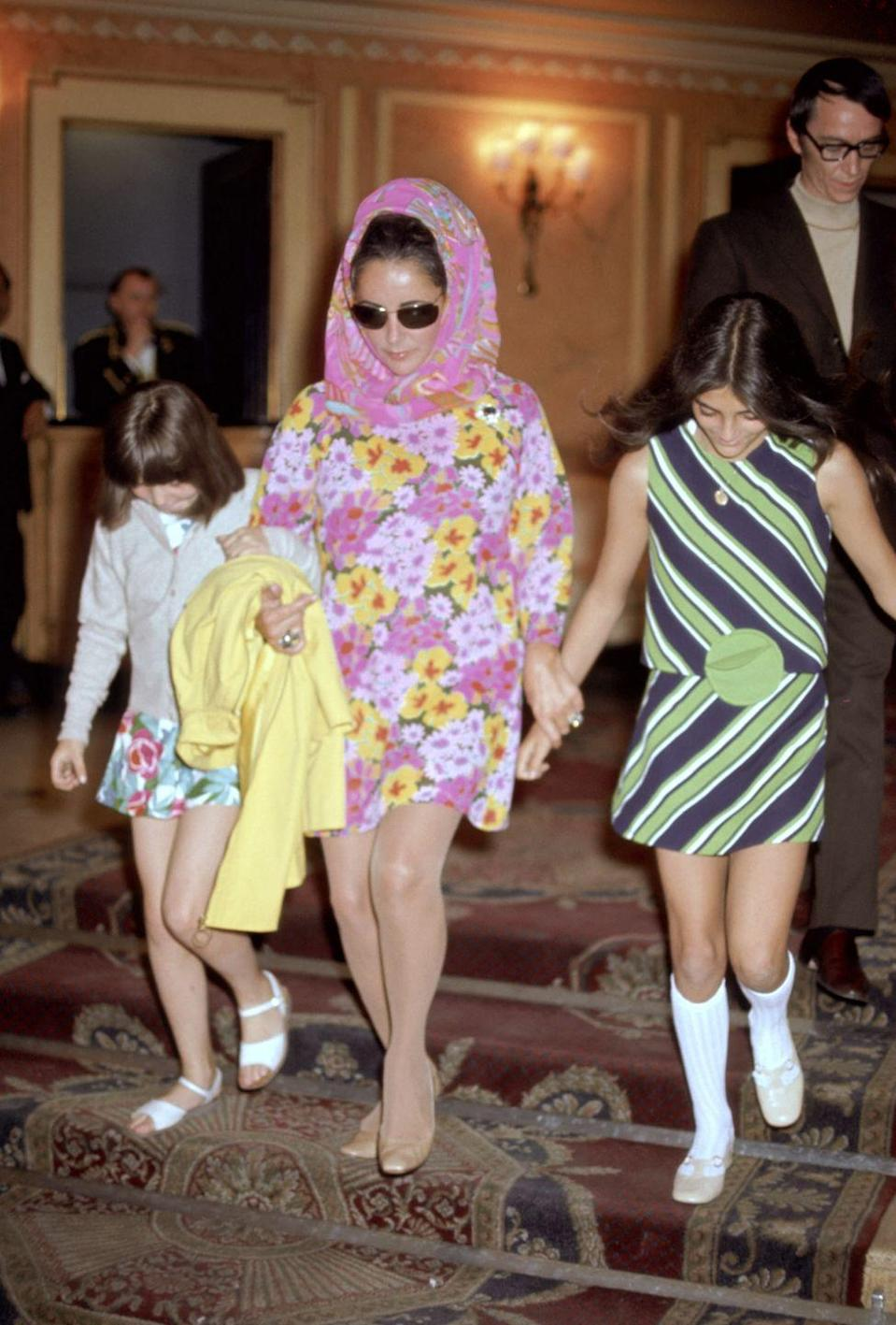 <p>In 1982 London, Taylor walked with her daughters, Maria Burton and Liza Todd.</p>