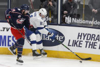 Tampa Bay Lightning's Erik Cernak, right, keeps the puck away from Columbus Blue Jackets' Liam Foudy during the second period of an NHL hockey game Thursday, Jan. 21, 2021, in Columbus, Ohio. (AP Photo/Jay LaPrete)
