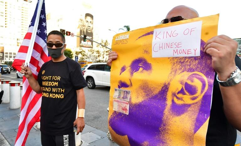 Protesters outside the Staples Center direct ire at Lakers star LeBron James over his comments after the China furore (AFP Photo/Frederic J. BROWN)