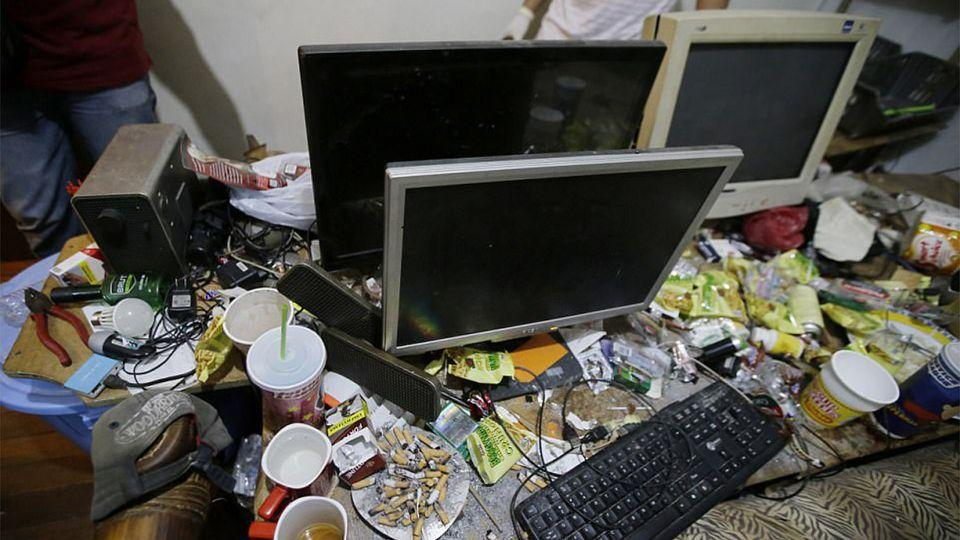 Webcams, monitors and countless hard drives were located on the scene. Source: AP