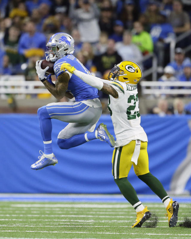 Detroit Lions wide receiver Kenny Golladay makes a reception as Green Bay Packers cornerback Jaire Alexander (23) defends during the first half of an NFL football game, Sunday, Dec. 29, 2019, in Detroit. (AP Photo/Duane Burleson)