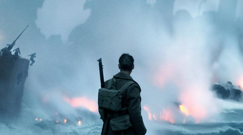 A soldier (we believe it may be Tom Hardy) against a devastating backdrop. (Credit: Warner Bros)