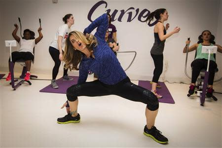 Fitness guru Jillian Michaels gives instructions while promoting her new workout in New York