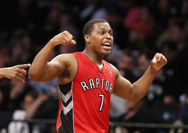 Toronto Raptors guard Kyle Lowry (7) reacts in waning minutes of the second half of Game 4 of an NBA basketball first-round playoff series against the Brooklyn Nets at the Barclays Center, Sunday, April 27, 2014, in New York. The Raptors evened the series at 2-2, defeating the Nets 87-79. (AP Photo/Kathy Willens)