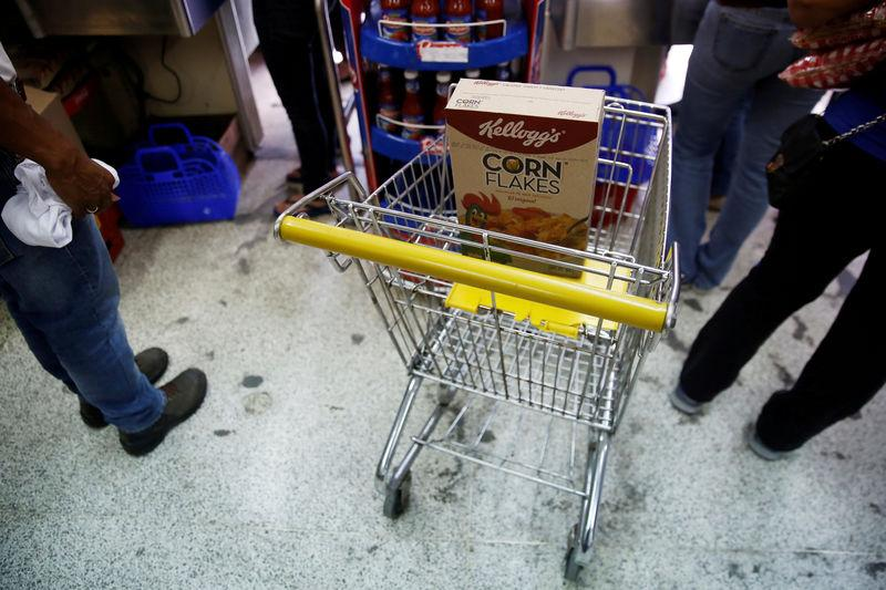 A box of corn flakes made by Kellogg is seen on a shopping cart inside a local shop in Caracas