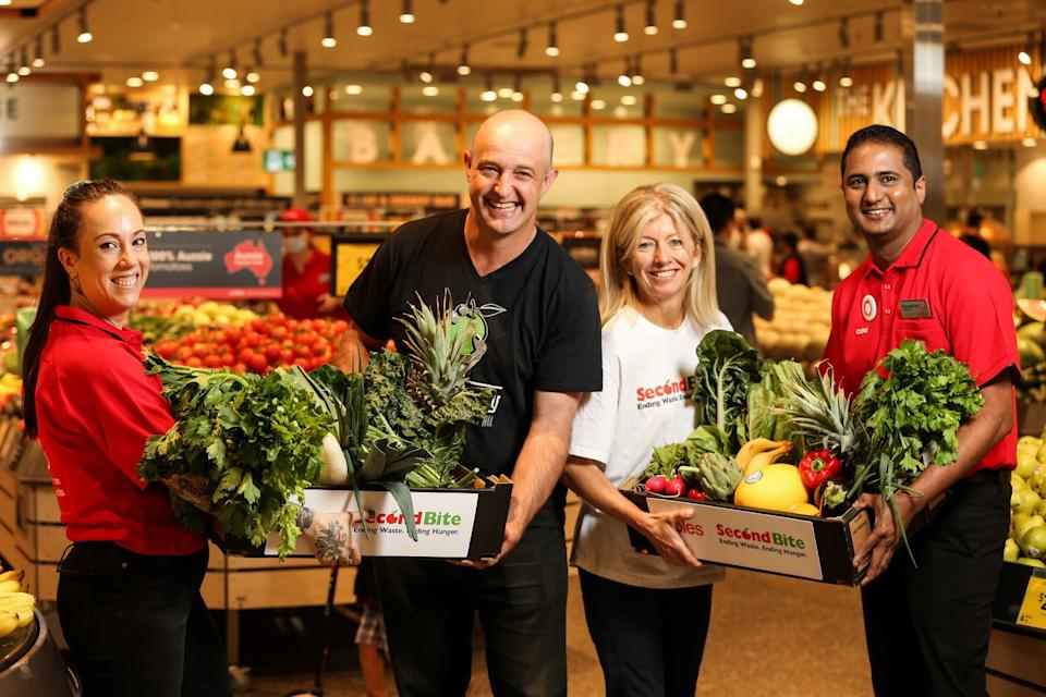 Foodbank, Secondbite and Coles team members holding food. Source: Coles