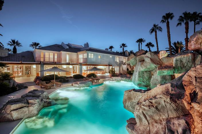 """<p>Lighting allows swimmers to enjoy the interesting nooks and crannies of this unique pool day or night. (All photos via <a href=""""http://bit.ly/1OjQdjg"""" rel=""""nofollow noopener"""" target=""""_blank"""" data-ylk=""""slk:Concierge Auctions listing"""" class=""""link rapid-noclick-resp"""">Concierge Auctions listing</a>)</p>"""