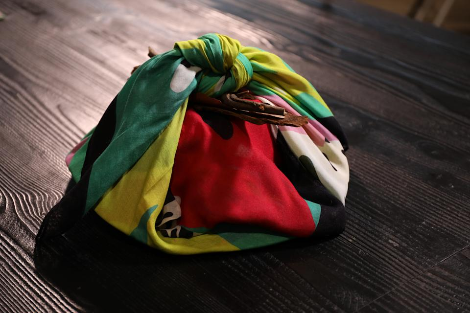 When your gift includes an item of clothing, you can use that to wrap the rest. Photo: Yahoo Lifestyle