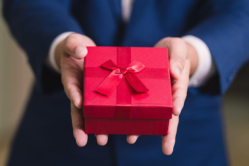 Pictured: Employee with Christmas gift. Image: Getty