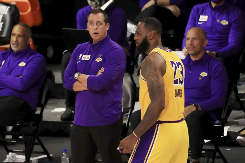 Los Angeles Lakers coach Frank Vogel talks with LeBron James during the fourth quarter of the team's NBA basketball game against the Los Angeles Clippers on Thursday, July 30, 2020, in Lake Buena Vista, Fla. (Mike Ehrmann/Pool Photo via AP)