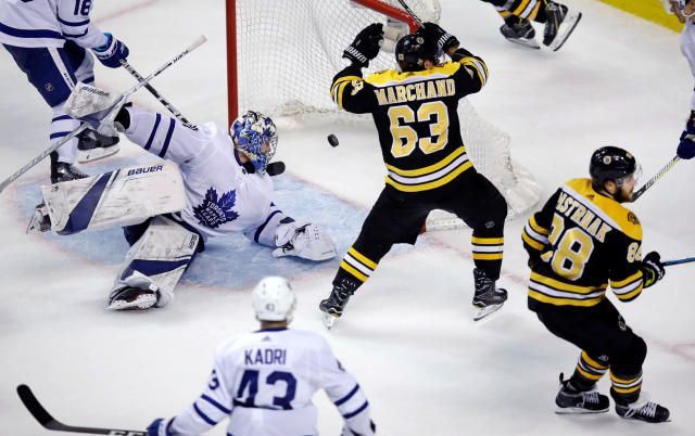 Toronto Maple Leafs goaltender Frederik Andersen looks back as the puck bounces to the back of the net on a goal by Boston Bruins right wing David Pastrnak (88) during the third period of Game 7 of an NHL hockey first-round playoff series in Boston, Wednesday, April 25, 2018. At center is Bruins left wing Brad Marchand (63). (AP Photo/Charles Krupa)