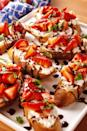 """<p>This appetizer comes together in, oh, five minutes and will make your friends fall in love with you (and balsamic glaze).</p><p>Get the recipe from <a href=""""https://www.delish.com/cooking/recipe-ideas/recipes/a54145/strawberry-balsamic-bruschetta-recipe/"""" rel=""""nofollow noopener"""" target=""""_blank"""" data-ylk=""""slk:Delish"""" class=""""link rapid-noclick-resp"""">Delish</a>. </p>"""