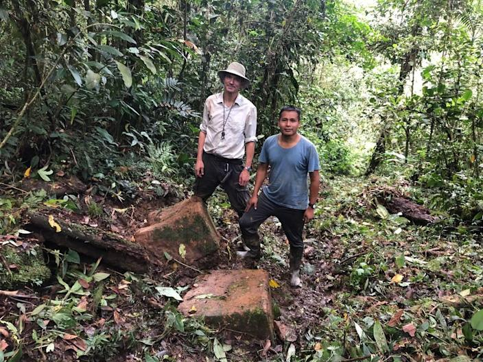 Stefan Ansermet, left, a consulting geologist for Aurania Resources, and Faustino Tsenkush, an exploration geologist for Aurania Resources, stand on the trail they believe is an old Spanish road leading to lost gold mine in southeastern Ecuador.
