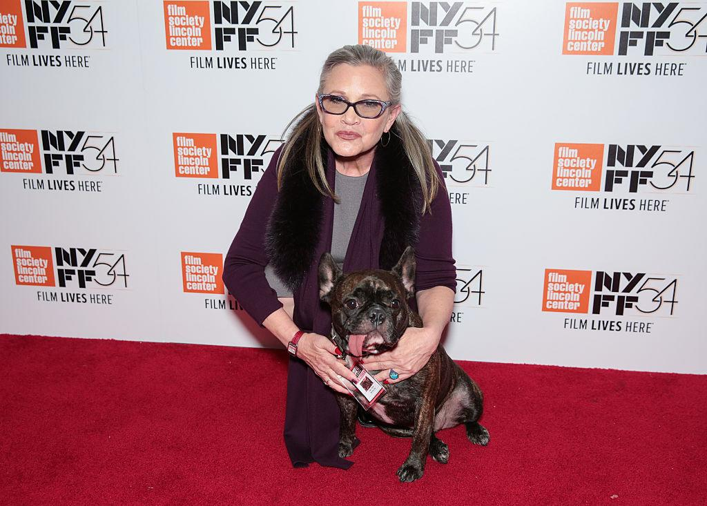 <p>Fisher and Gary were regulars on the festival scene. Here they attended the <i>Bright Lights</i> screening in October. Gary gave the film one tongue out. (Photo: CJ Rivera/FilmMagic) </p>
