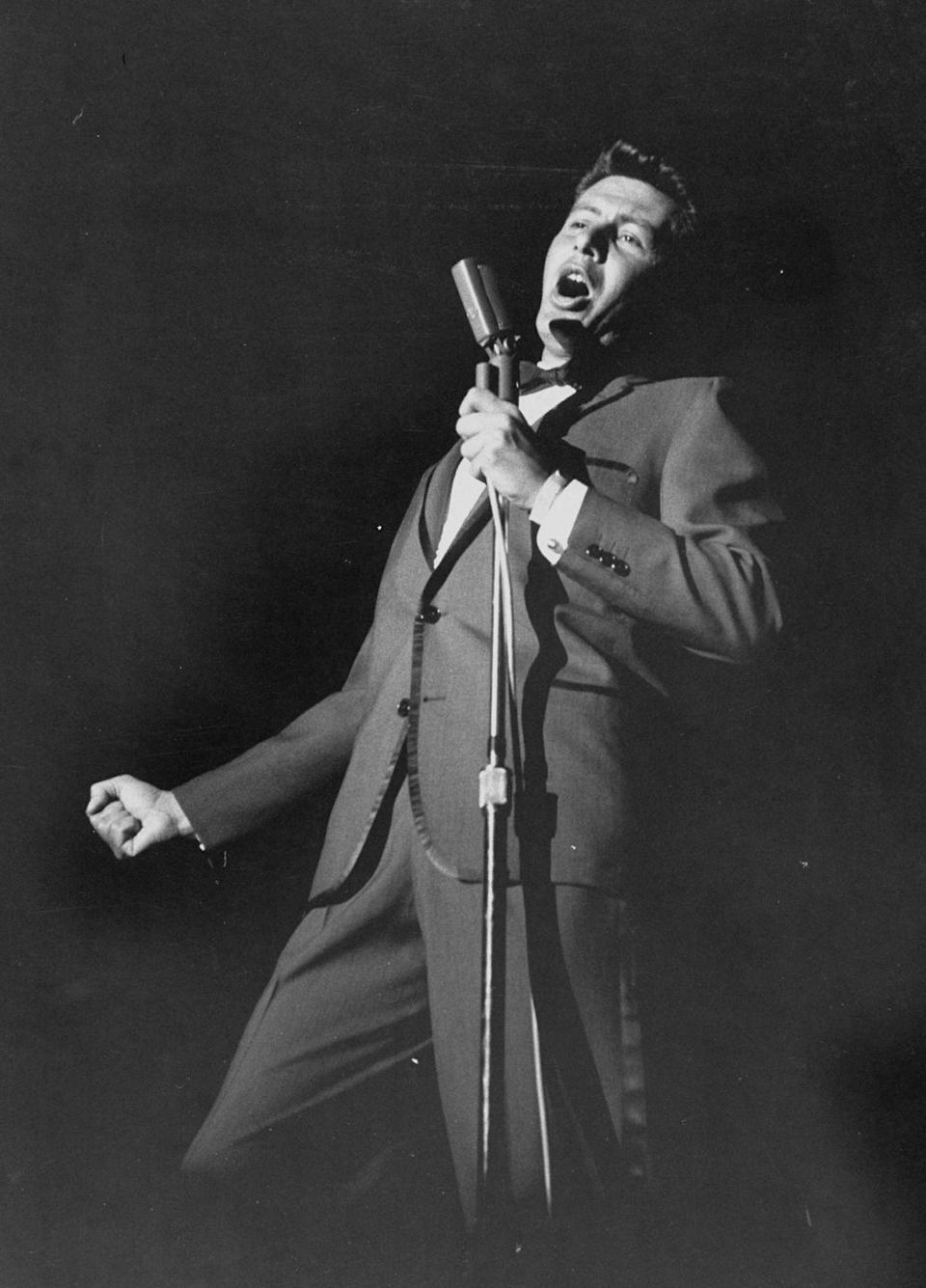 <p>Eddie Fisher performs in 1958. He was one of the most popular artists during the '50s and even hosted his own TV show.</p>