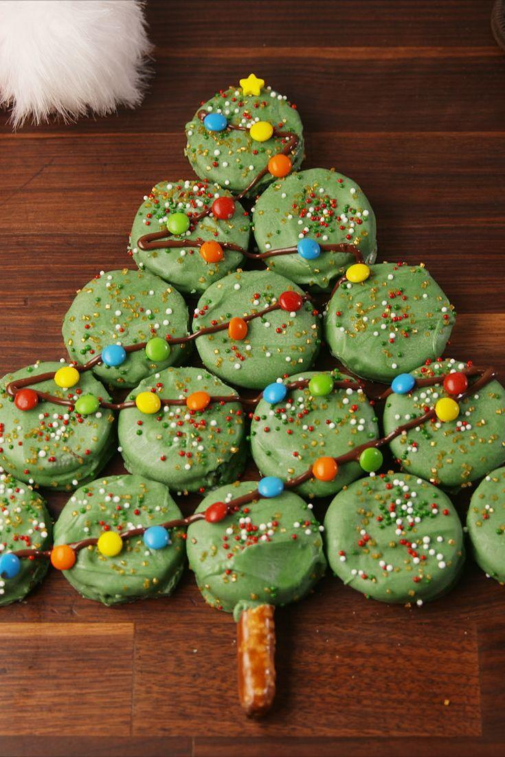 """<p>The cutest and easiest Christmas treat to serve this year.</p><p>Get the recipe from <a href=""""https://www.delish.com/cooking/recipe-ideas/recipes/a57120/oreo-christmas-tree-recipe/"""" rel=""""nofollow noopener"""" target=""""_blank"""" data-ylk=""""slk:Delish"""" class=""""link rapid-noclick-resp"""">Delish</a>. </p>"""