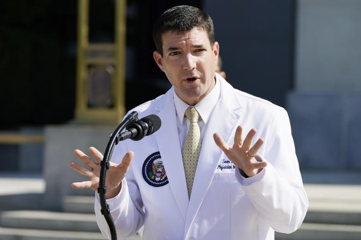 Dr. Sean Conley briefs reporters at Walter Reed National Military Medical Center in Bethesda, Md.