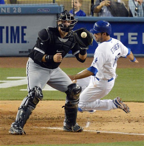 Los Angeles Dodgers' Andre Ethier, right, scores on a single by A.J. Ellis as Chicago White Sox catcher A.J. Pierzynski takes a late throw during the third inning of a baseball game, Saturday, June 16, 2012, in Los Angeles. (AP Photo/Mark J. Terrill)