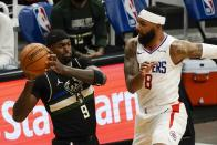 Milwaukee Bucks' Bobby Portis looks to pass around LA Clippers' Marcus Morris Sr. during the first half of an NBA basketball game Sunday, Feb. 28, 2021, in Milwaukee. (AP Photo/Morry Gash)