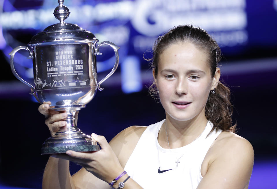 Daria Kasatkina of Russia holds her trophy after winning the final match against Margarita Gasparyan of Russia in the St. Petersburg Ladies Trophy 2021 tennis tournament final match in St.Petersburg, Russia, Sunday, March 21, 2021. (AP Photo/Dmitri Lovetsky)