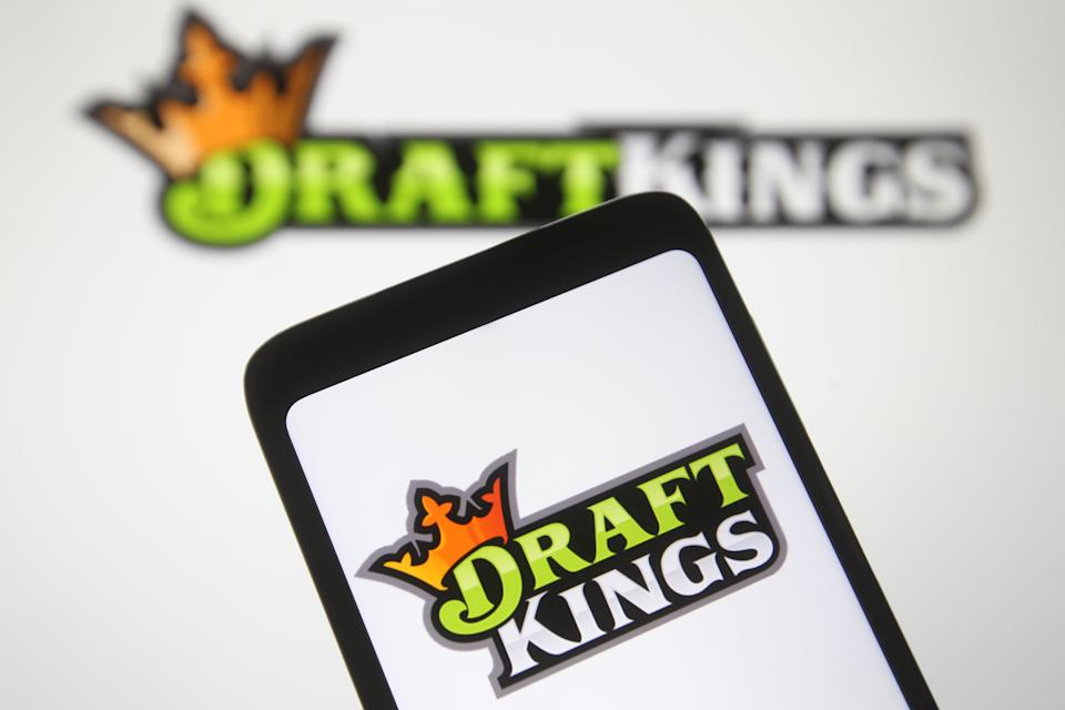 UKRAINE - 2021/02/04: In this photo illustration a DraftKings logo, of the U.S. daily fantasy sports contest and sports betting operator, is seen on a mobile phone screen. (Photo Illustration by Pavlo Gonchar/SOPA Images/LightRocket via Getty Images)