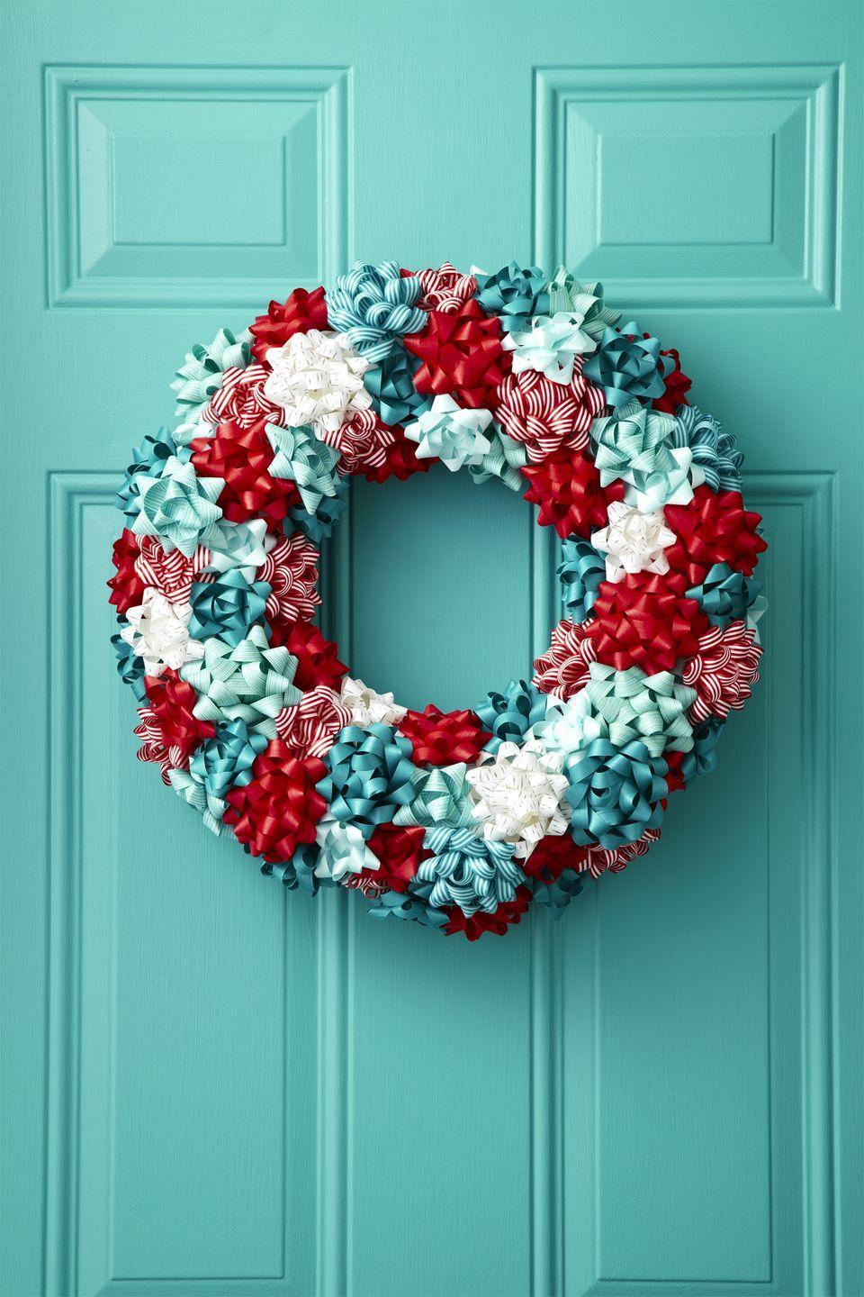 "<p>For a burst of color, embellish a plain foam wreath with leftover bows from last year's wrapping. </p><p><a class=""link rapid-noclick-resp"" href=""https://www.amazon.com/Tatuo-Christmas-Metallic-Adhesive-Decorating/dp/B07HSZ6PXX/?tag=syn-yahoo-20&ascsubtag=%5Bartid%7C10055.g.2361%5Bsrc%7Cyahoo-us"" rel=""nofollow noopener"" target=""_blank"" data-ylk=""slk:SHOP GIFT BOWS"">SHOP GIFT BOWS</a><br></p>"