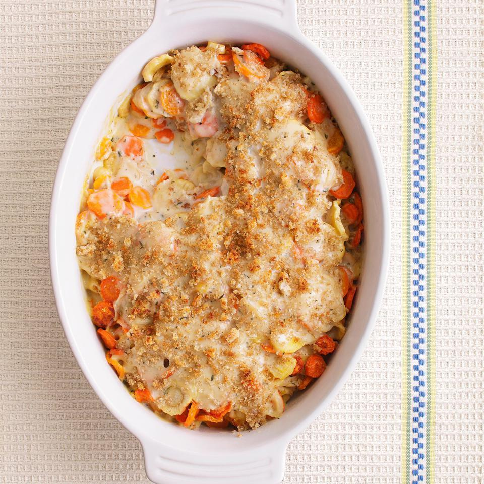 "<p>Make this creamy carrot-and-parsnip casserole for your next holiday meal--everyone will beg you for the recipe! Our healthier version skips the heavy cream and butter found in most recipes--saving about 160 calories and 12 grams of saturated fat compared to a traditional version.</p> <p> <a href=""http://www.eatingwell.com/recipe/250375/carrot-parsnip-gratin/"" rel=""nofollow noopener"" target=""_blank"" data-ylk=""slk:View recipe"" class=""link rapid-noclick-resp""> View recipe </a></p>"
