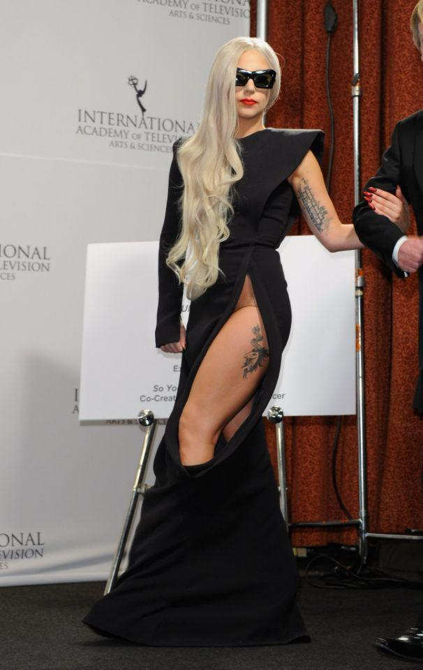 <p>The singer and actress took it to thigh-tattoo territory at the International Emmys in 2011. Show attendees were treated to a unicorn sighting — and a glimpse of Gaga's tummy. (Photo: Getty Images) </p>