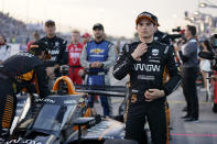 Pato O'Ward (5) stands next to his car before the start an IndyCar auto race at World Wide Technology Raceway on Saturday, Aug. 21, 2021, in Madison, Ill. (AP Photo/Jeff Roberson)
