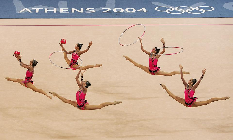 ATHENS - AUGUST 28: The Russian team compete in the hoops and balls during the rhythmic gymnastics group finals on August 28, 2004 during the Athens 2004 Summer Olympic Games at the Galatsi Olympic Hall in Athens, Greece. (Photo by Ian Waldie/Getty Images)