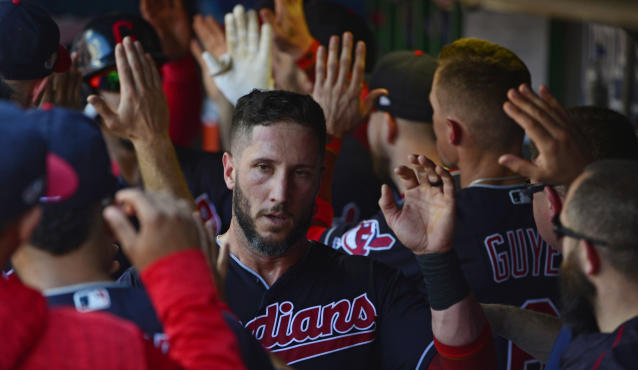 Cleveland Indians' Yan Gomes is congratulated by teammates after scoring in the third inning during Game 3 of baseball's American League Division Series against the Houston Astros, Monday, Oct. 8, 2018, in Cleveland. (AP Photo/Phil Long)