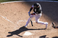 Chicago White Sox's Yasmani Grandal swings into a game-winning single off Tampa Bay Rays relief pitcher Pete Fairbanks during the 10th inning of a baseball game Wednesday, June 16, 2021, in Chicago. (AP Photo/Charles Rex Arbogast)