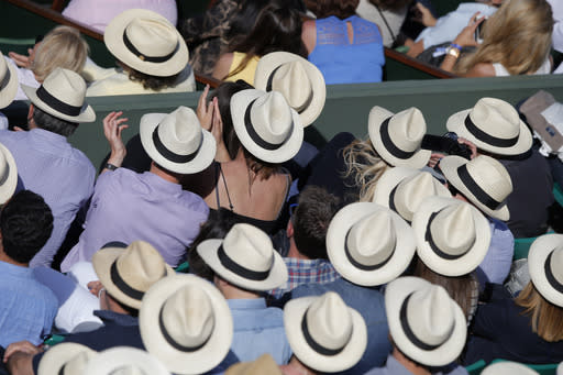 Spectators wear hats to shield themselves from the sun as France's Richard Gasquet plays his third round match of the French Open tennis tournament against South Africa's Kevin Anderson at the Roland Garros stadium, in Paris, France, Saturday, May 30, 2015. (AP Photo/Francois Mori)