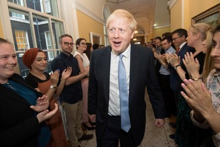 Britain's Prime Minister Boris Johnson is welcomed in 10 Downing Street by staff after meeting Britain's Queen Elizabeth II and accepting her invitation to become Prime Minister and form a new government