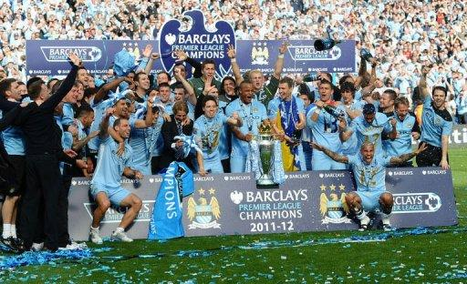 City players celebrate with the Premier League trophy