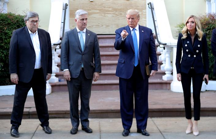 Donald Trump stands in front of St. John's Episcopal Church across from the White House with U.S. Attorney General Bill Barr, National Security Advisor Robert O'Brien and White House Press Secretary Kayleigh McEnany after walking there for a photo opportunity during ongoing protests over racial inequality in the wake of the death of George Floyd while in Minneapolis police custody, at the White House in Washington, U.S., June 1, 2020. (Tom Brenner/Reuters)