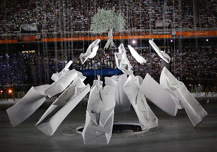 """<p>Greece, the birth place of the Olympics, hosts for the first time since the first Modern Olympiad of 1896. The opening ceremony paid tribute to Greek achievements, history, and mythology. Here, the founding myth of Athens is recreated as a rock <a href=""""http://www.bizbash.com/behind_the_scenes_of_the_2004_olympic_opening_ceremony/new-york/story/4273/#.V5u4tsc0nBI"""" rel=""""nofollow noopener"""" target=""""_blank"""" data-ylk=""""slk:struck by a javelin thrown by Athena"""" class=""""link rapid-noclick-resp"""">struck by a javelin thrown by Athena</a> opens to reveal an olive tree. </p>"""